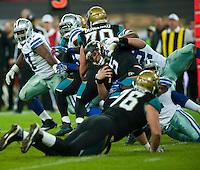09.11.2014.  London, England.  NFL International Series. Jacksonville Jaguars versus Dallas Cowboys. Jacksonville Jaguars' Quarterback Blake Bortles (#5) is sacked