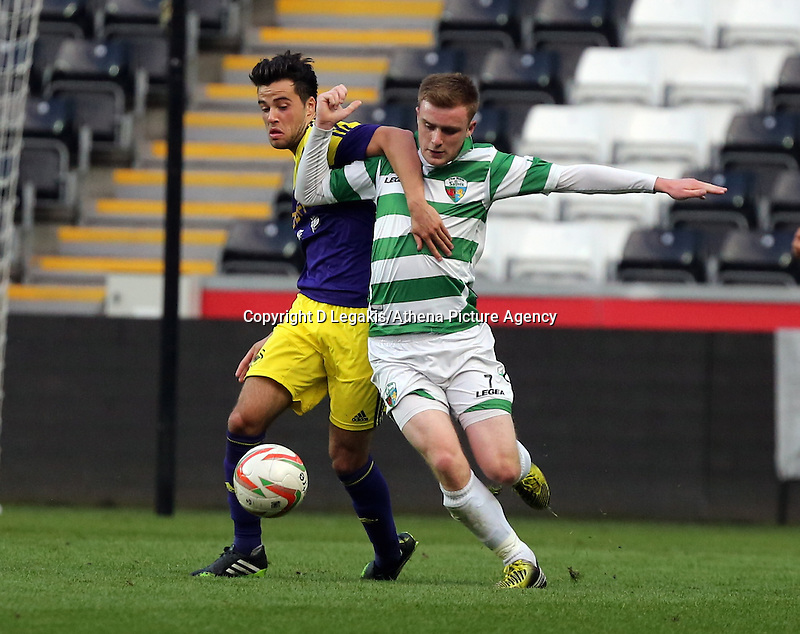 Thursday, 16 April 2014<br /> Pictured L-R: Sam Evans of Swansea challenged by Rhys Cooper of TNS <br /> Re: FAW Youth Cup Final, Swansea City FC v The New Saints FC at the Liberty Stadium, south Wales,