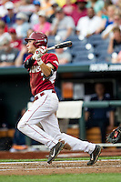 Arkansas Razorbacks third baseman Bobby Wernes (7) follows through on his swing against the Virginia Cavaliers in Game 1 of the NCAA College World Series on June 13, 2015 at TD Ameritrade Park in Omaha, Nebraska. Virginia defeated Arkansas 5-3. (Andrew Woolley/Four Seam Images)