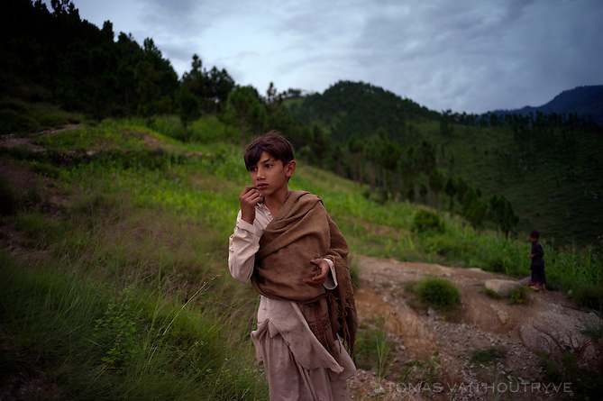 A Pashtun boy looks over the village of Barhampati in the Swat valley, Pakistan, on Aug. 25, 2010.