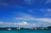 beach and sky with sailboats at anchor in Vessup Bay. St Thomas, US Virgin Islands Caribbean.