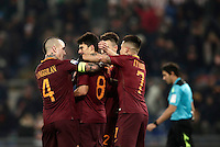 Calcio, Serie A: Roma vs ChievoVerona. Roma, stadio Olimpico, 22 settembre 2016.<br /> Roma's Diego Perotti, second from left, celebrates with teammates Radja Nainggolan, left, Stephan El Shaarawy, second from right, and Juan Iturbe, after scoring on a penalty kick during the Italian Serie A football match between Roma and Chievo Verona, at Rome's Olympic stadium, 22 December 2016.<br /> UPDATE IMAGES PRESS/Isabella Bonotto