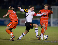 Austin Savage (5) of Clemson tries to carry the ball away from Jake Pace (20) of Maryland during the game at the Maryland SoccerPlex in Germantown, MD. Maryland defeated Clemson, 1-0, in overtime.  With the win the Terrapins advanced to the finals of the ACC men's soccer tournament.