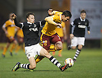 Conor Townsend tackles Motherwell's John Sutton