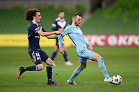 6th June 2021; AAMI Park, Melbourne, Victoria, Australia; A League Football, Melbourne Victory versus Melbourne City; Florin Berenguer of Melbourne City passes the ball as Jay Barnett of the Victory challenges
