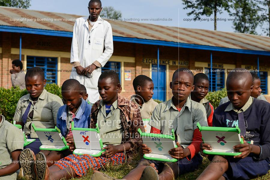 RWANDA, Ruhengeri, Initiative One laptop per child OLPC founded by Nicholas Negroponte, children using a XO laptop at Primary school