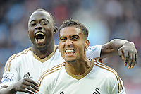 Kyle Naughton of Swansea City celebrates setting up the winning goal with Modou Barrow of Swansea City during the Barclays Premier League match between Aston Villa v Swansea City played at the Villa Park Stadium, Birmingham on October 24th 2015