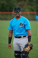 Miami Marlins catcher Miguel Pena (6) during warmups before a Minor League Extended Spring Training game against the New York Mets on April 12, 2019 at First Data Field Complex in St. Lucie, Florida.  (Mike Janes/Four Seam Images)