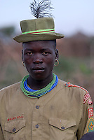 UGANDA Karamoja, Kotido, Karimojong pastoral tribe, warrior in army look / UGANDA Karamoja, Kotido, Karimojong Halbnomaden, Krieger im Armee look