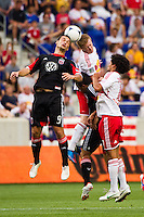 Hamdi Salihi (9) of DC United and Dax McCarty (11) of the New York Red Bulls go up for a header. The New York Red Bulls defeated DC United 3-2 during a Major League Soccer (MLS) match at Red Bull Arena in Harrison, NJ, on June 24, 2012.