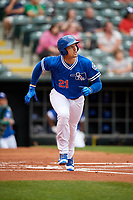 Oklahoma City Dodgers center fielder Trayce Thompson (21) runs to first base during a game against the Colorado Springs Sky Sox on June 2, 2017 at Chickasaw Bricktown Ballpark in Oklahoma City, Oklahoma.  Colorado Springs defeated Oklahoma City 1-0 in ten innings.  (Mike Janes/Four Seam Images)