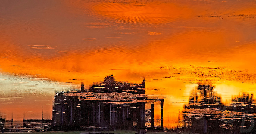 Abstract reflections at Angkor Wat during sunset in Water, Cambodia