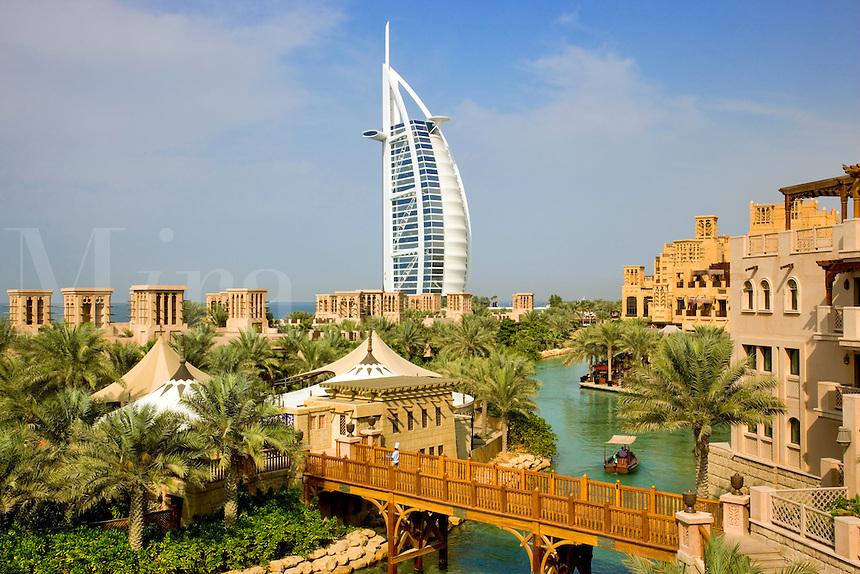 Dubai.  Burj al Arab Hotel, Al Qasr Hotel and Mina A'Salam Hotel at the Madinat Jumeirah. Chef on bridge.  .