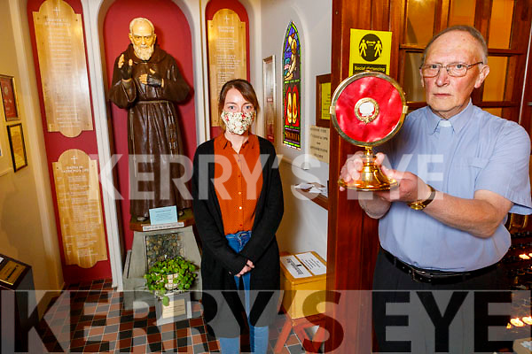 Fr Mossie Brick and Juliette Culloty holding a relic of Padre Pio at the evening devotion to Padre Pio in the Church of Saints Stephen and St John in Castleisland on Tuesday.