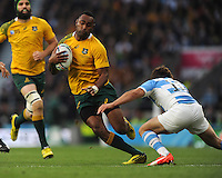 Tevita Kuridrani of Australia is tackled by Nicolas Sanchez of Argentina during the Semi Final of the Rugby World Cup 2015 between Argentina and Australia - 25/10/2015 - Twickenham Stadium, London<br /> Mandatory Credit: Rob Munro/Stewart Communications