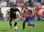 Sporting de Gijon's Oscar Guido Trejo (r) and FC Barcelona's Pedro Rodriguez during La Liga match.October 2,2011. (ALTERPHOTOS/Acero)