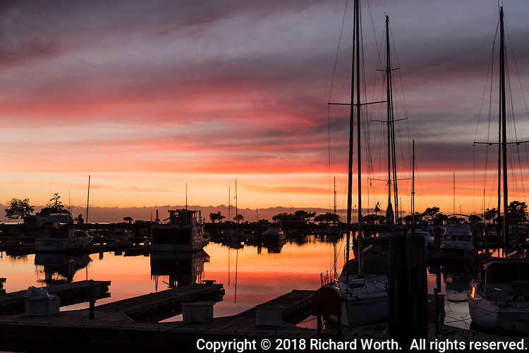 Sunset paints the sky and the water at the San Leandro Marina on San Francisco Bay.