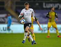 2nd January 2021; Liberty Stadium, Swansea, Glamorgan, Wales; English Football League Championship Football, Swansea City versus Watford; Jay Fulton of Swansea City controls the ball while under pressure from Tom Cleverley of Watford