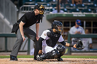 Charlotte Knights catcher Roberto Pena (12) sets a target as home plate umpire Eric Gillam looks on during the game against the Durham Bulls at BB&T BallPark on May 15, 2017 in Charlotte, North Carolina. The Knights defeated the Bulls 6-4.  (Brian Westerholt/Four Seam Images)