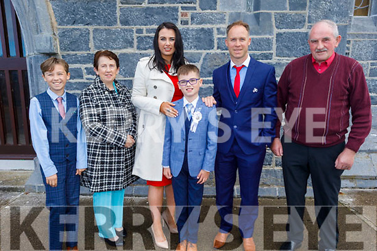 Jamie Fahy receiving his First Holy Communion in Ardfert on Saturday.<br /> L to r: Taylor, Marie Wallace, Caroline and Stephen Fahy and Frank Wallace