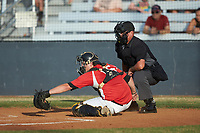 Lake Norman Copperheads catcher Damon Massey (15) (West Virginia St) reaches for a pitch as home plate umpire Britt Kennerly looks on during the game against the Mooresville Spinners at Moor Park on July 6, 2020 in Mooresville, NC.  The Spinners defeated the Copperheads 3-2. (Brian Westerholt/Four Seam Images)