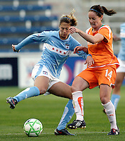 Chicago Red Star defender Marian Dalmy (2) attempts to clear the ball while being pressured by Sky Blue FC midfielder Collette McCallum (14).  The Sky Blue FC defeated the Chicago Red Stars 2-0 at Toyota Park in Bridgeview, IL on May 10, 2009.