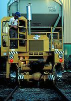 Workman prepares to move chemical hopper car with a track mobile. Orange Texas USA.