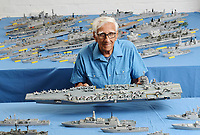 BNPS.co.uk (01202) 558833<br /> Pic: ZacharyCulpin/BNPS<br /> <br /> Pictured: Philip Warren with his brand new models of the Gerald Ford US aircraft carrier (at the back centre), HMS Glasgow (third left) and HMS Trent (forth left).<br /> <br /> A master modeller who was inundated with hundreds of rare matchboxes after appealing for donations has used them to build a 3ft long aircraft carrier.<br /> <br /> Now Philip Warren has added the impressive model to his so-called matchbox fleet of miniature ships which have gone on display in an exhibition.<br /> <br /> Mr Warren's 72 year pastime of building model warships had looked as though it had come to an end earlier this year when he ran out of the traditional wooden boxes he used to make the hull and decks.<br /> <br /> But the 90-year-old was sent more than 300 of the lightweight matchboxes made from aspen wood in response to his plea for more.