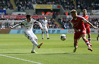 Saturday, 03 May 2014<br /> Pictured L-R: Pablo Hernandez of Swansea crosses the ball past Luke Shaw of Southampton. <br /> Re: Barclay's Premier League, Swansea City FC v Southampton at the Liberty Stadium, south Wales.