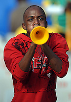 A local fan blows on a plastic horn. Brazil defeated USA 3-0 during the FIFA Confederations Cup at Loftus Versfeld Stadium in Tshwane/Pretoria, South Africa on June 18, 2009.