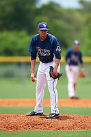 GCL Rays relief pitcher Jesus Ortiz (18) looks in for the sign during the first game of a doubleheader against the GCL Twins on July 18, 2017 at Charlotte Sports Park in Port Charlotte, Florida.  GCL Twins defeated the GCL Rays 11-5 in a continuation of a game that was suspended on July 17th at CenturyLink Sports Complex in Fort Myers, Florida due to inclement weather.  (Mike Janes/Four Seam Images)