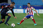 Atletico de Madrid´s Gabi (R) and Olympiacos´s Afellay during Champions League soccer match between Atletico de Madrid and Olympiacos at Vicente Calderon stadium in Madrid, Spain. November 26, 2014. (ALTERPHOTOS/Victor Blanco)