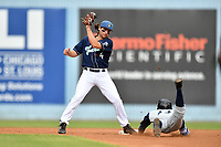 Asheville Tourists shortstop Ryan Vilade (4) fields the ball as Hansel Moreno (12) slides in safely during game one of a double header against the Columbia Fireflies at McCormick Field on August 4, 2018 in Asheville, North Carolina. The Tourists defeated the Fireflies 5-1. (Tony Farlow/Four Seam Images)