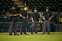 Umpires Jon-Tyler Shaw, Kenny Jackson, Chandler Durham, and Joe McCarthy during Game One of the Low-A Southeast Championship Series between the Tampa Tarpons and Bradenton Marauders on September 21, 2021 at LECOM Park in Bradenton, Florida.  (Mike Janes/Four Seam Images)