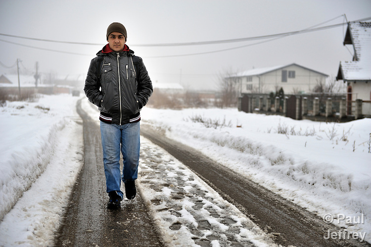 Bajram Kruezi walks through the Zemun Polje neighborhood of Belgrade, Serbia, on his way to the Branko Pesic School, an educational center for Roma children and families which is supported by Church World Service. Kruezi's family came to Belgrade as refugees from Kosovo, and like many Roma can't afford regular school fees. Many Roma also lack legal status in Serbia, and thus have difficulty obtaining formal employment and accessing government services. Kruezi wants to be a Muslim religious scholar when he grows up.