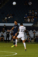 KANSAS CITY, KS - OCTOBER 07: #11 Khiry Shelton of Sporting Kansas City and #22 Mauricio Pineda of Chicago Fire FC jump up to head the ball during a game between Chicago Fire and Sporting Kansas City at Children's Mercy Park on October 07, 2020 in Kansas City, Kansas.