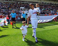 FAO SPORTS PICTURE DESK<br /> Pictured: Swansea captain Ashley Williams holding his son and escorting Hari Kieft (L) to the pitch, who had a revolutionary operation in the USA to walk, thanks to the fumdraising efforts of Williams. Sunday, 13 May 2012<br /> Re: Premier League football, Swansea City FC v Liverpool FC at the Liberty Stadium, south Wales.