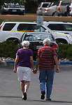 Ethlyn and Howard MacDonald walk back to their car outside the IHOP restaurant in Carson City, Nev., on Wednesday, Sept. 7, 2011. The couple was inside the restaurant with family members when gunman Eduardo Sencion opened fire Tuesday, killing four people and injuring seven others before taking his own life. (AP Photo/Cathleen Allison)