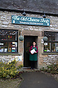 16/12/16<br /> ***WITH PICS***<br /> <br /> Claire Millner outside The Old Cheese Shop in Hartington where their traditional Blue Stilton is sold.<br /> More than 1,800 of these traditional Christmas Blue Stilton cheeses have already left Hartington Creamery, in the heart of the Derbyshire Peak District, but with just one more week left before the big day, there are still another 150 of the giant 8kg cheese cylinders to reach maturity and be shipped out in time to partner the post-feast glass of port on December 25th.<br /> <br /> FULL STORY: https://fstoppressblog.wordpress.com/christmas-blue-stilton-from-derbyshire/<br /> <br /> All Rights Reserved: F Stop Press Ltd. +44(0)1773 550665  www.fstoppress.com