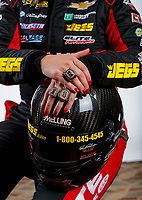 Feb 6, 2020; Pomona, CA, USA; Detailed view as NHRA pro stock driver Erica Enders poses for a portrait with her championship rings during NHRA Media Day at the Pomona Fairplex. Mandatory Credit: Mark J. Rebilas-USA TODAY Sports