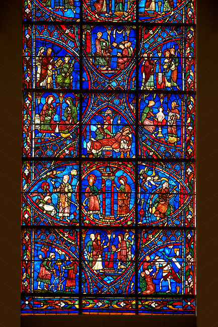 Medieval Windows of the Gothic Cathedral of Chartres, France, dedicated to the life of the Virgin Mary.  The bottom centre oval panel shows Anna and Joachim meet at the Golden Gate, below The high priest refuses the offerings of Joachim, left Annunciation to Joachim , right Annunciation to Anna .  . A UNESCO World Heritage Site.