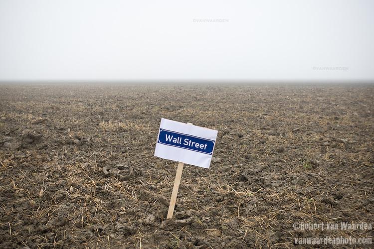 Wallstreet sign in an empty field.