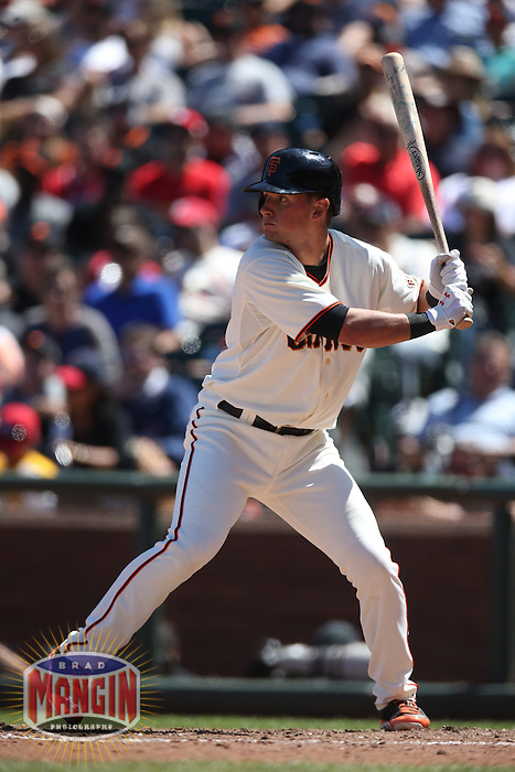 SAN FRANCISCO, CA - JULY 3:  Joe Panik #12 of the San Francisco Giants bats against the St. Louis Cardinals during the game at AT&T Park on Thursday, July 3, 2014 in San Francisco, California. Photo by Brad Mangin