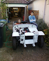 BNPS.co.uk (01202 558833)<br /> Pic: DavidTownend/BNPS<br /> <br /> Pictured: David's children Michael and daughter Kayleigh with the car back in the 1990's<br /> <br /> A dad who bought a run down sports car the year his first child was born has finished restoring it 27 years later - just in time for his son's wedding.<br /> <br /> David Townend, 60, bought the 1974 MG Midget in 1994 for almost £300.<br /> <br /> He kept the rusty motor in his garage with the intention of returning it to its former glory.<br /> <br /> But 'life got in the way' and the restoration project was put on the back burner.