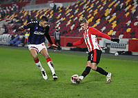 9th January 2021; Brentford Community Stadium, London, England; English FA Cup Football, Brentford FC versus Middlesbrough; Marcus Forss of Brentford covered by Nathan Wood of Middlesbrough