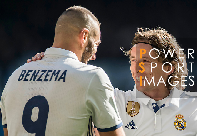 Karim Benzema (l) of Real Madrid celebrates with teammates  Luka Modric of Real Madrid during their La Liga match between Real Madrid and Granada CF at the Santiago Bernabeu Stadium on 07 January 2017 in Madrid, Spain. Photo by Diego Gonzalez Souto / Power Sport Images