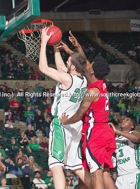 North Texas Mean Green forward Niko Stojiljkovic (25) and Louisiana Lafayette Ragin Cajuns guard Elfrid Payton (2) in action during the game between the Louisiana Lafayette Ragin Cajuns and the University of North Texas Mean Green at the North Texas Coliseum,the Super Pit, in Denton, Texas. Louisiana Lafayette defeats UNT 57 to 53.