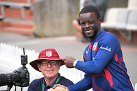 Windies media manager Dario Barthley gives Photosport photographer Andrew Cornaga a bucket hat during day three of the second International Test Cricket match between the New Zealand Black Caps and West Indies at the Basin Reserve in Wellington, New Zealand on Sunday, 13 December 2020. Photo: Dave Lintott / lintottphoto.co.nz