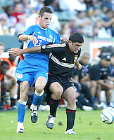 14 November 2004: Alecko Eskandarian of DC United fights for the ball against Alex Zotinca of Kansas City during the first half of the game of MLS CUP at Home Depot Center in Carson, California...Mandatory Credit: Michael Pimentel / www.internationalsportsimages.com..