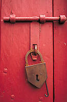 hand forged lock on wooden door